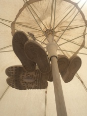 This is how we tie our sandals on the umbrella :)