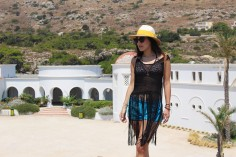 Wearing Just Cavalli shorts and bikini, Hawaiana flip-flops, Asos fringed top, H&M hat, Silvian Heach backpack.