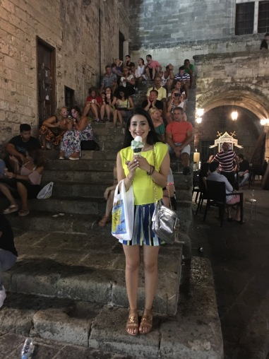 Enjoying an ice-cream at the Old Town of Rhodes. Total outfit by Silvian Heach, Just Cavalli cross-bag and Versace Jeans sandals.