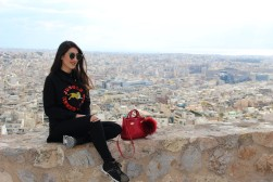 Wearing; Versace Jeans shoes, Anel jeans, Kenzo sweater, CavallI Class bag and Fendi sunglasses.