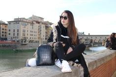 Wearing Jimmy Choo sunglasses, Silvian Heach sweater, Gucci sneakers, Cavalli Class backpack, Flo Clo pom poms.
