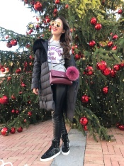 Wearing IDDI puffer coat, Silvian Heach leather leggings and sweater, Just Cavalli sneakers, Cavalli Class cross bag and Gucci sunglasses.